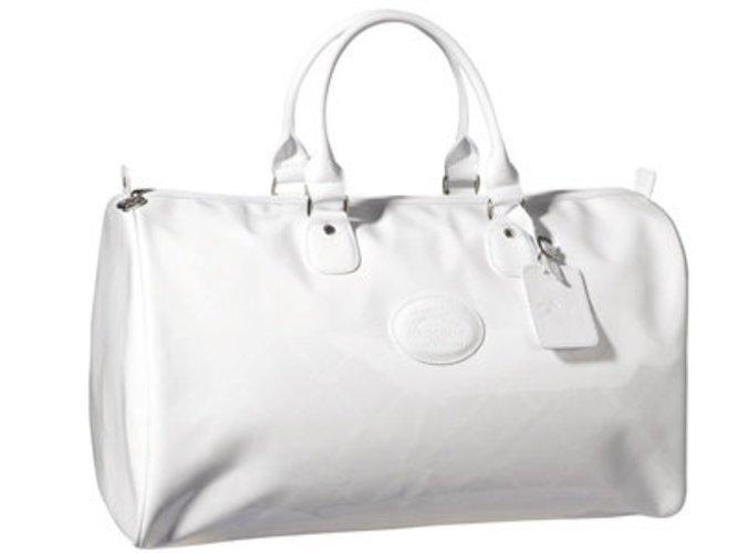 Weiße Duffle Bag von Longchamp aus der Sommerkollektion 2009. Aus weißem Leder mit Lack.