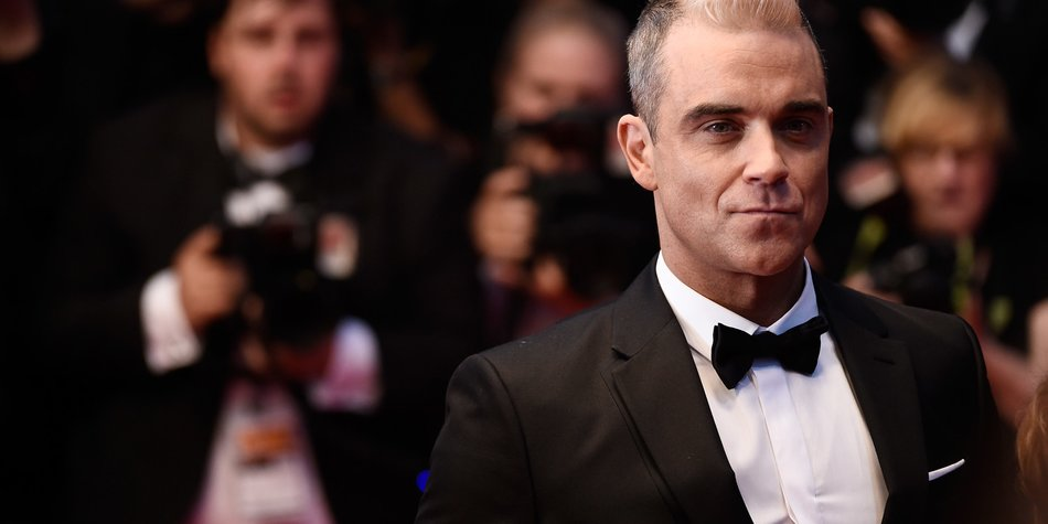 Robbie-Williams_Ian-Gavan_GettyImages-473636510