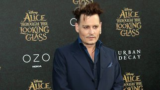 """HOLLYWOOD, CA - MAY 23: Actor Johnny Depp attends the premiere of Disney's """"Alice Through The Looking Glass at the El Capitan Theatre on May 23, 2016 in Hollywood, California. (Photo by Frederick M. Brown/Getty Images)"""
