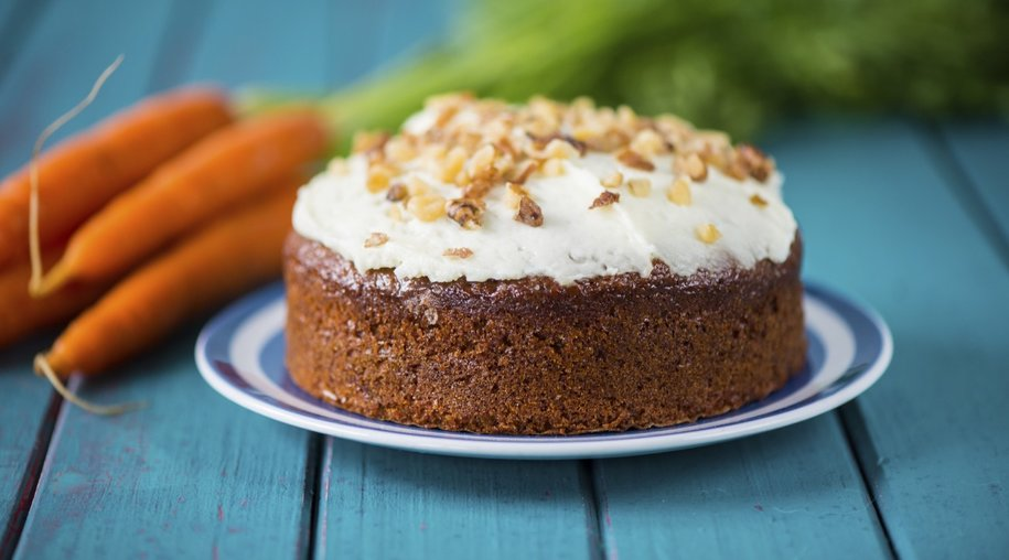 Traditional homemade carrot cake and fresh carrots