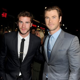 """HOLLYWOOD, CA - NOVEMBER 04:  Actors Liam Hemsworth (L) and Chris Hemsworth arrive at the premiere of Marvel's """"Thor: The Dark World"""" at the El Capitan Theatre on November 4, 2013 in Hollywood, California.  (Photo by Kevin Winter/Getty Images)"""