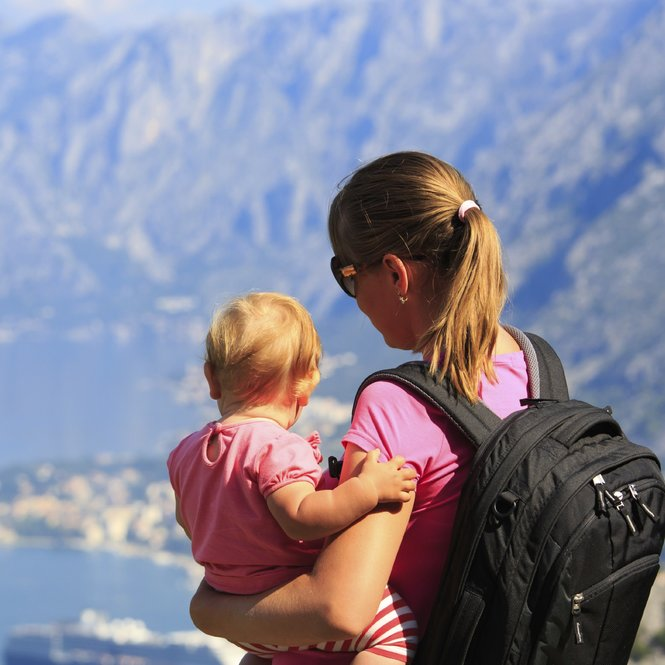 mother with little daughter travel hiking in mountains