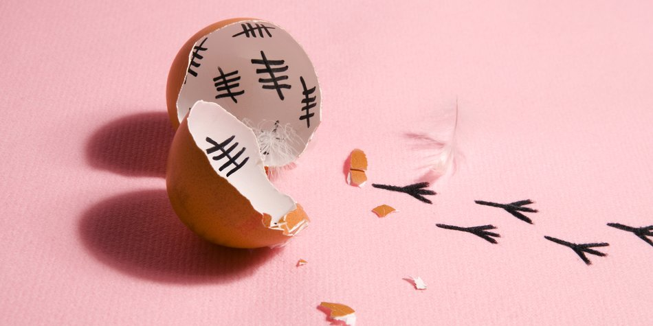 The counting of the days on a broken egg with footprint on a pink and blue background