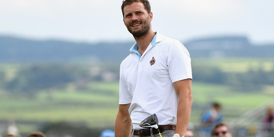 LONDONDERRY, NORTHERN IRELAND - JULY 05: Jamie Dornan tees off on the 16th during the Pro-Am of the Dubai Duty Free Irish Open at Portstewart Golf Club on July 5, 2017 in Londonderry, Northern Ireland. (Photo by Ross Kinnaird/Getty Images)