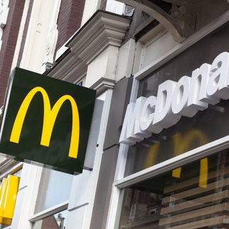 """Amsterdam, The Netherlands - April 12, 2012: McDonald's branch in Amsterdam, The Netherlands. McDonald's is the leading global fast food chain and can be found in many countries across the globe."""