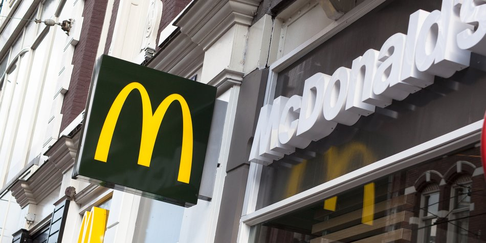 """""""Amsterdam, The Netherlands - April 12, 2012: McDonald's branch in Amsterdam, The Netherlands. McDonald's is the leading global fast food chain and can be found in many countries across the globe."""""""