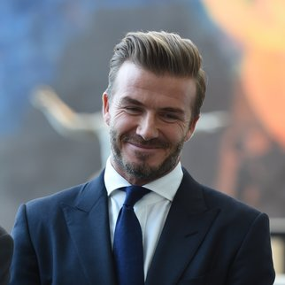 UNICEF Goodwill Ambassador David Beckham tours a installation at the United Nations General Assembly on September 24, 2015, after a press conference to announce the Assembly of Youth, a digital installation created by UNICEF.  AFP PHOTO /  TIMOTHY  A. CLARY        (Photo credit should read TIMOTHY A. CLARY/AFP/Getty Images)
