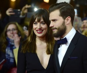 US actor Jamie Dornan and US actress Dakota Johnson pose for photographers on the red carpet as they arrive for the screening of Fifty 'Shades of Grey' as part of Berlinale Special Gala at the 65th Berlin International Film Festival Berlinale in Berlin, on February 11, 2015. AFP PHOTO / JOHN MACDOUGALL (Photo credit should read JOHN MACDOUGALL/AFP/Getty Images)