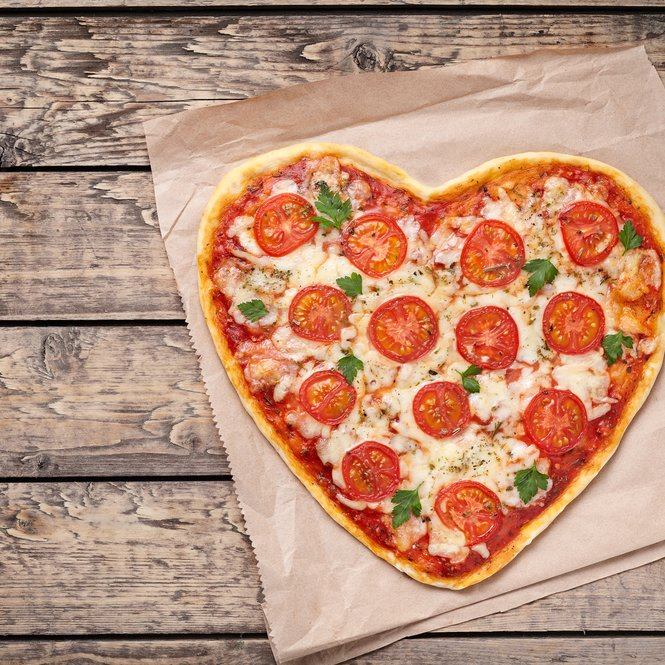 Heart shaped pizza margherita with tomatoes and mozzarella for Valentines