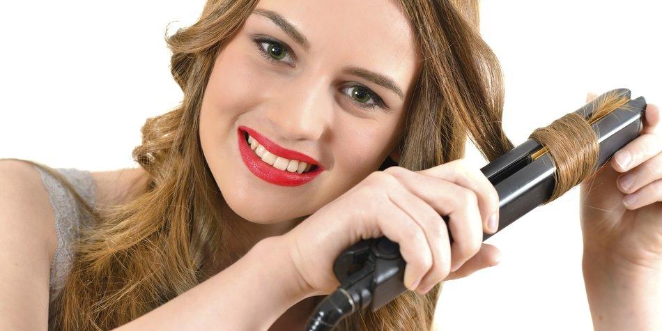 Beautiful woman ceramic hair straightener isolated on white