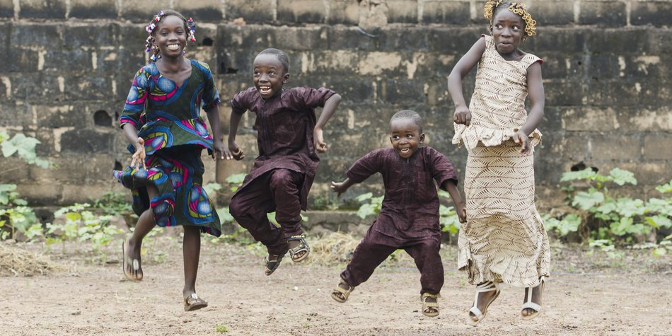 Little african children jumping and having fun in front of camera