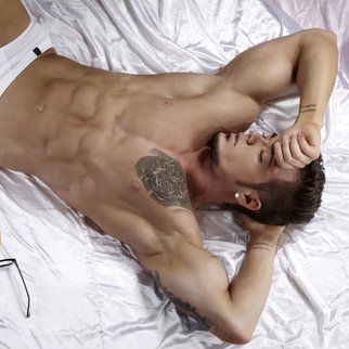 Top view of sexual tattooed guy in briefs