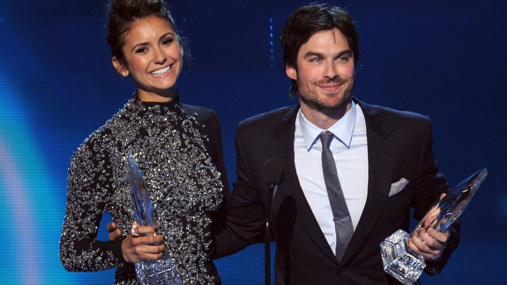 "LOS ANGELES, CA - JANUARY 08: Actors Nina Dobrev (L) and Ian Somerhalder, winners of the Favorite On Screen Chemistry award for ""The Vampire Diaries,"" speak onstage at The 40th Annual People's Choice Awards at Nokia Theatre L.A. Live on January 8, 2014 in Los Angeles, California. (Photo by Kevin Winter/Getty Images)"