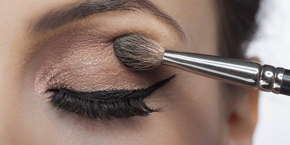 Makeup close-up. Eyebrow makeup, long eyelashes, brush.