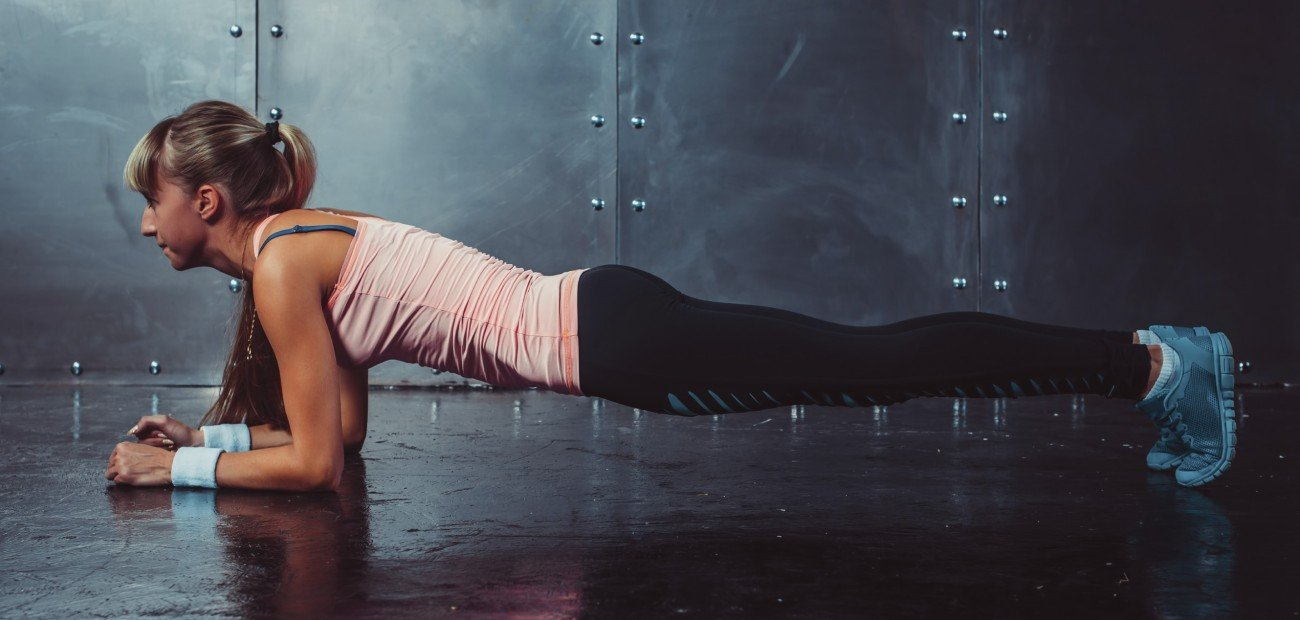 Slim fitness young woman Athlete girl doing plank exercise concept training work out gymnastics