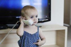 Baby, 9 Monate, kommuniziert.