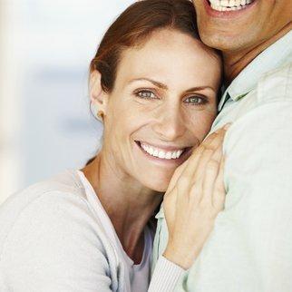 Portrait of smiling beautiful woman hugging man