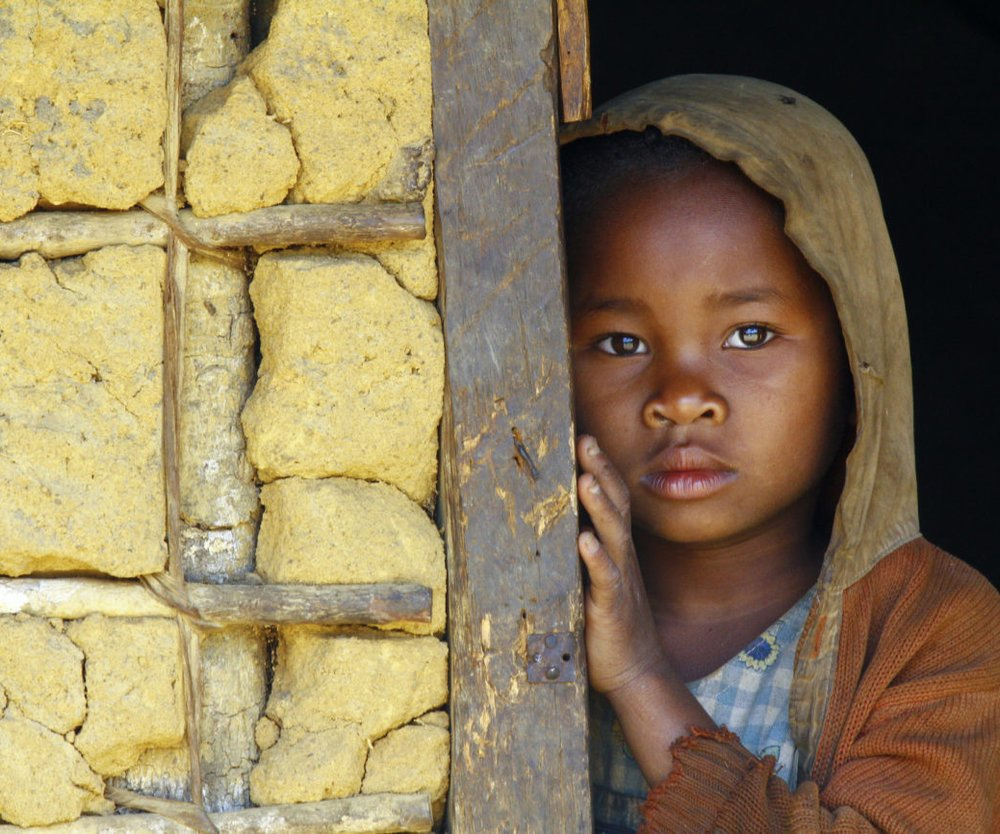 Madagascar-shy and poor african girl with headkerchief