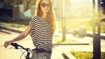 Trendy Hipster Girl with Bike on Urban Background. Toned and Filtered Photo. Modern Youth Lifestyle Concept.