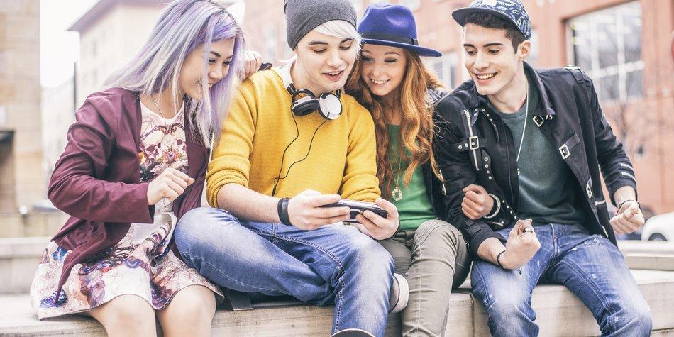 Teenagers meeting outdoors