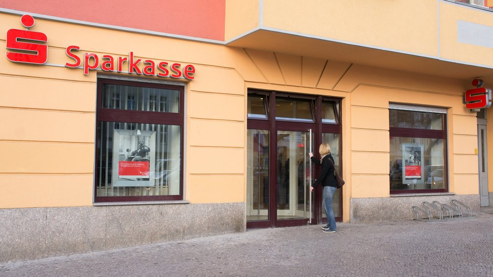 """""""Berlin, Germany - March 16, 2012: Branch of the local public Bank """"""""Sparkasse"""""""". The Sparkasse is the most popular bank for small and medium clients in Germany. Sharing a common name among the group, the local banks work independent and are usually owned by the community."""""""