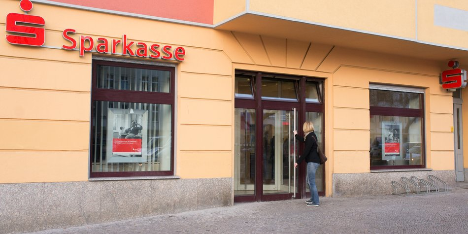 """Berlin, Germany - March 16, 2012: Branch of the local public Bank """"Sparkasse"""". The Sparkasse is the most popular bank for small and medium clients in Germany. Sharing a common name among the group, the local banks work independent and are usually owned by the community."""