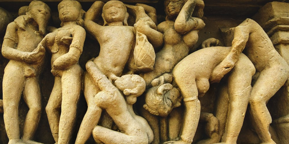 Famous erotic carvings at ancient Lakshmana Temple in Khajuraho, Madya Pradesh, India.