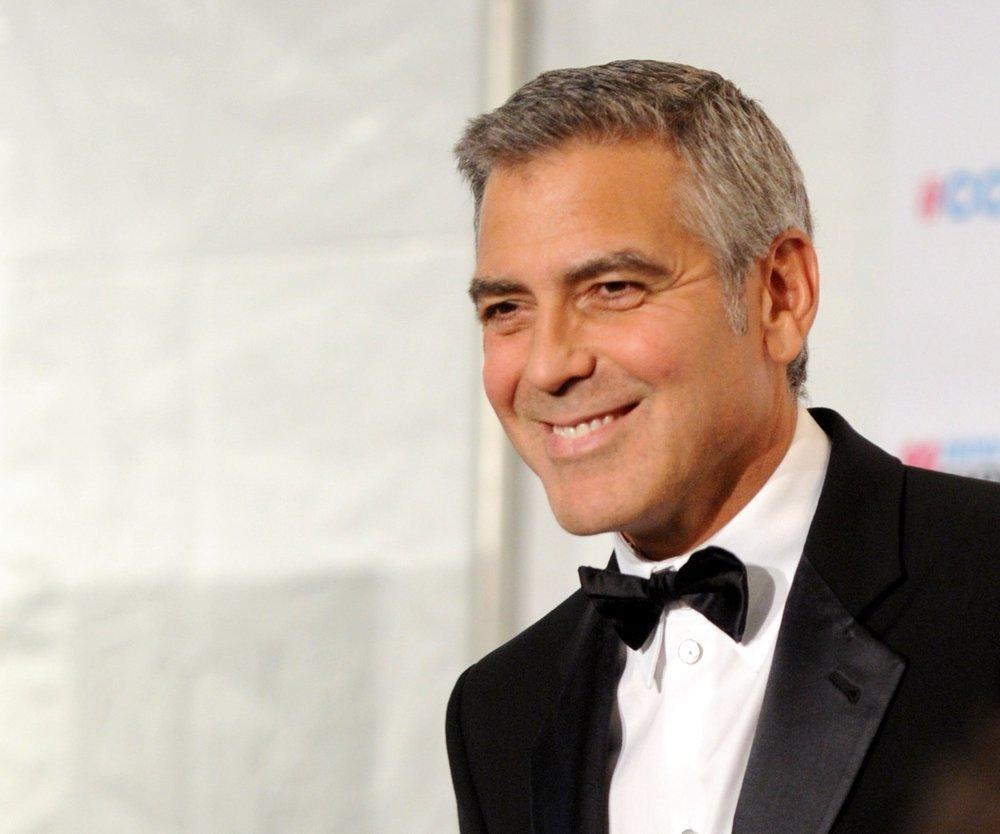 George Clooney liebt Angela Merkel