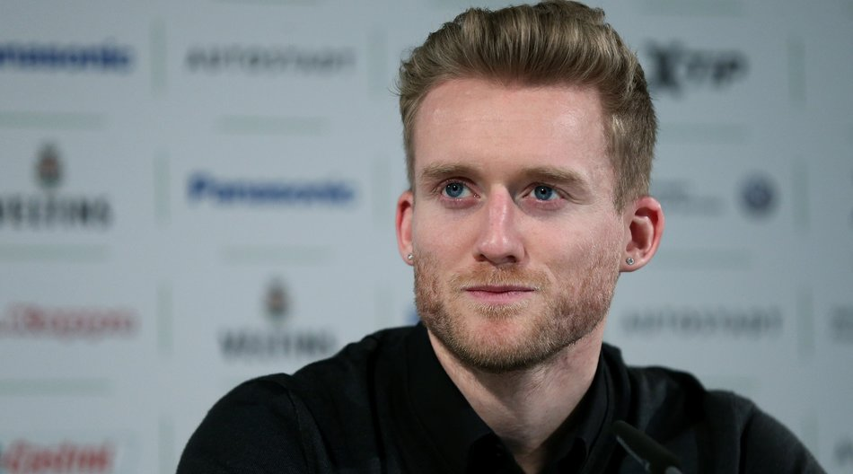 Newly signed German striker Andre Schuerrle who will play for German first division Bundesliga football club VfL Wolfsburg gives a press conference at the Volkswagen-Arena stadium in Wolfsburg, central Germany, on February 4, 2015. Schuerrle signed from English Premier League leaders Chelsea. AFP PHOTO / RONNY HARTMANN (Photo credit should read RONNY HARTMANN/AFP/Getty Images)
