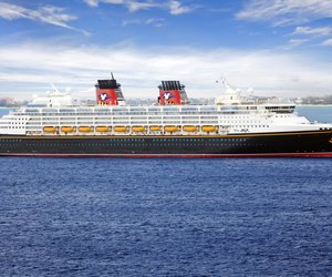 George Town, Cayman Islands - February 26, 2013: Disney Cruise Line, cruise ship Disney Magic Sailing from Port George Town on February 26, 2013. Disney Magic is one of the most admired and recognizable ocean liners in the world.