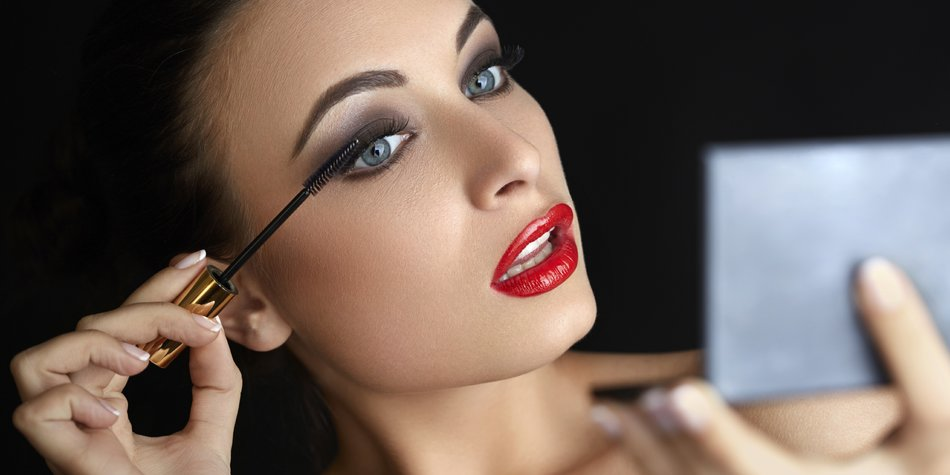 Make-up. Beautiful Woman Doing Makeup. Mascara Brush. Red Lips