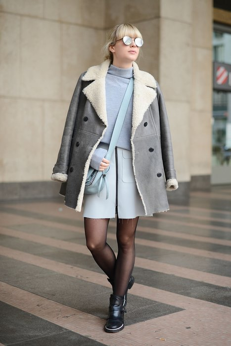 MILAN, ITALY - JANUARY 18: Lisa Dengler poses wearing a Tommy Hilfiger coat, Reiss sweater, Coach bag and Maje shoes during day 2 of Milan Menswear Fashion Week Fall/Winter 2015/2016 on January 18, 2015 in Milan, Italy. (Photo by Vanni Bassetti/Getty Images)