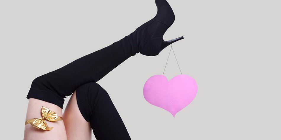 a beautyful female legs with pinky heart and yellow ribbon