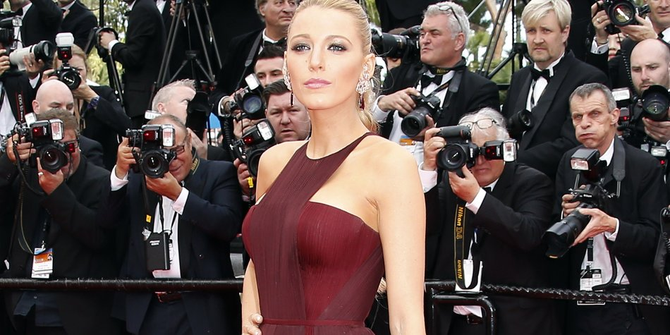 US actress Blake Lively poses as she arrives for the Opening ceremony of the 67th edition of the Cannes Film Festival in Cannes, southern France, on May 14, 2014. AFP PHOTO / VALERY HACHE (Photo credit should read VALERY HACHE/AFP/Getty Images)