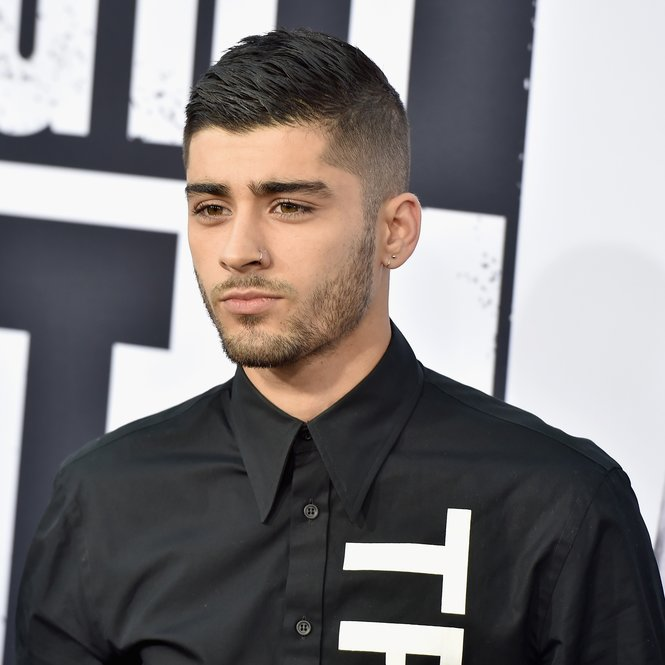 "LOS ANGELES, CA - AUGUST 10:  Singer  Zayn Malik attends the Universal Pictures and Legendary Pictures' premiere of ""Straight Outta Compton"" at Microsoft Theater on August 10, 2015 in Los Angeles, California.  (Photo by Kevin Winter/Getty Images)"