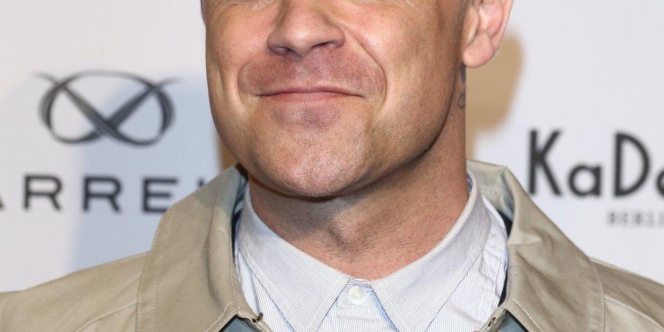 Robbie Williams entschuldigt sich auf seine eigene Art und Weise