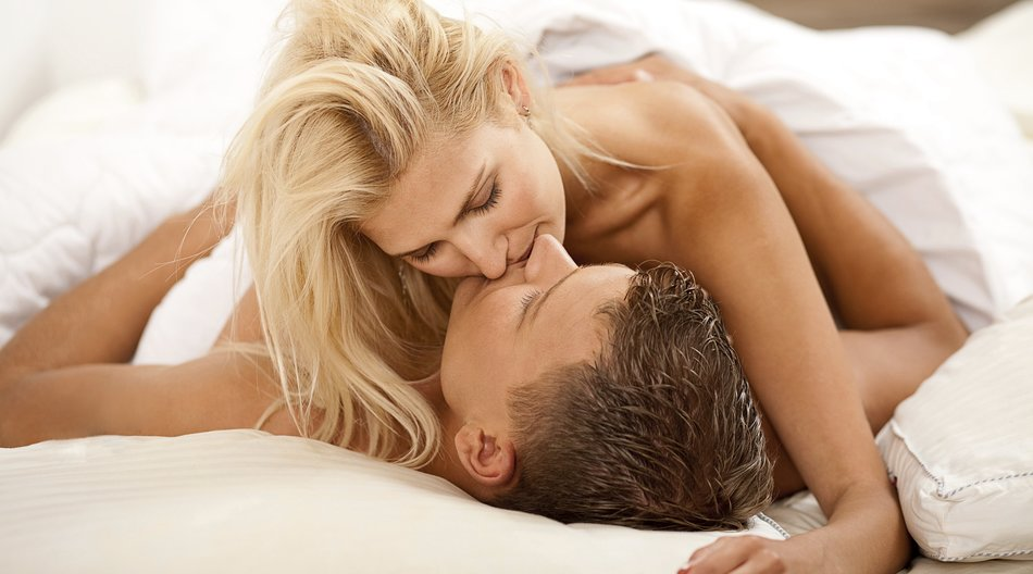 Intimate newlywed couple during the act of sex