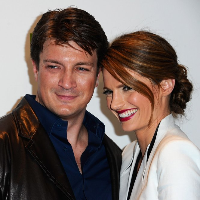 "BEVERLY HILLS, CA - MARCH 09: Actors Nathan Fillion and Stana Katic arrive to The Paley Center for Media's PaleyFest 2012 honoring ""Castle"" at Saban Theatre on March 9, 2012 in Beverly Hills, California. (Photo by Alberto E. Rodriguez/Getty Images)"