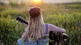 Beautiful hippie girl with a guitar