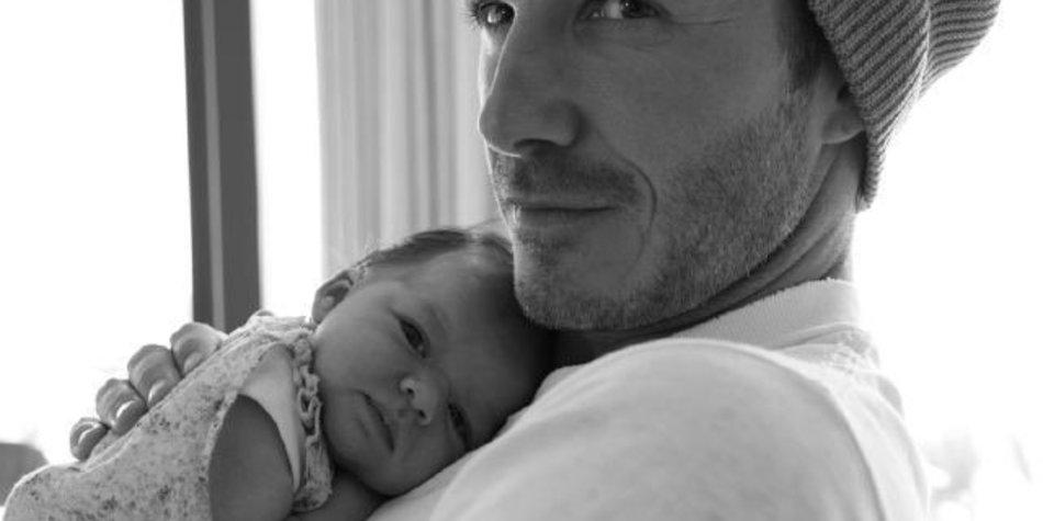 David Beckham stillt sein Kind