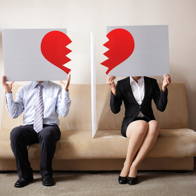 Divorce - Sad young couple holding billboard sign with break love heart, concept for divorce