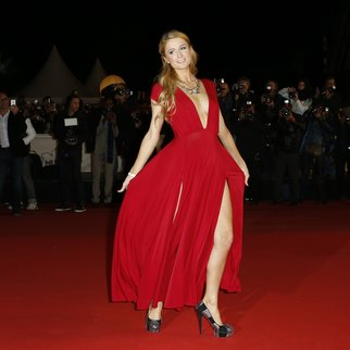 US actress and entertainer Paris Hilton poses upon her arrival at the Palais des Festivals to attend the 16th Annual NRJ Music Awards on December 13, 2014 in Cannes, southeastern France. AFP PHOTO / VALERY HACHE (Photo credit should read VALERY HACHE/AFP/Getty Images)