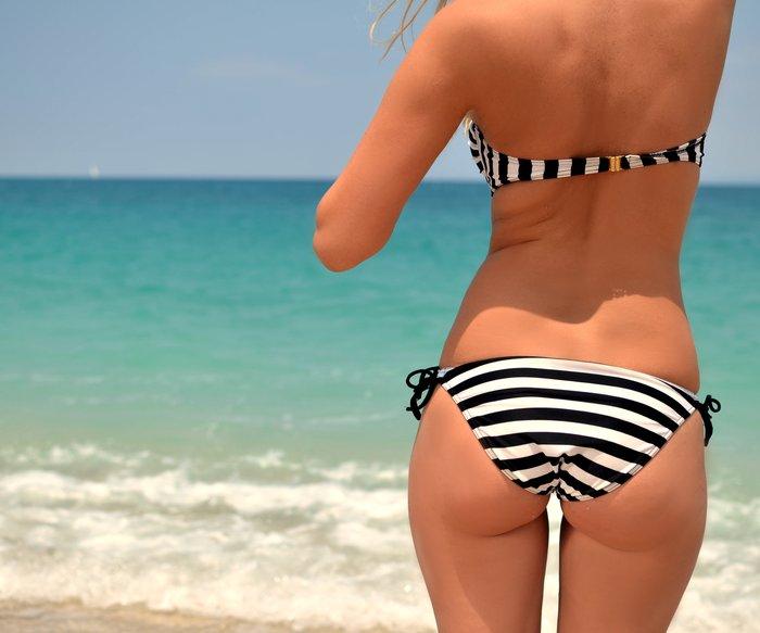 Beauty girl on sea background