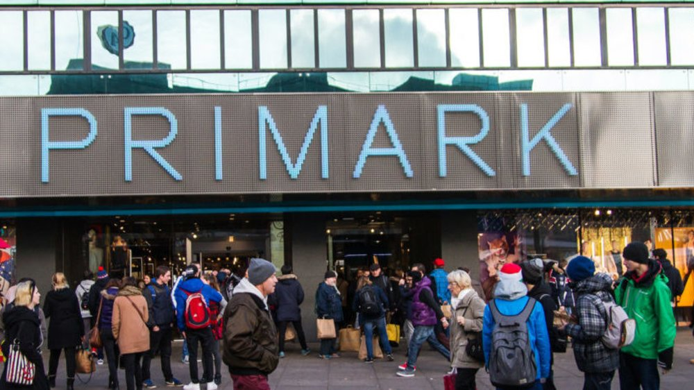 Berlin, Germany - December 9, 2014: The outside of the Primark clothes store in Berlin (Alexanderplatz) on a sunny day. Large vertical Primark logo on side of building.
