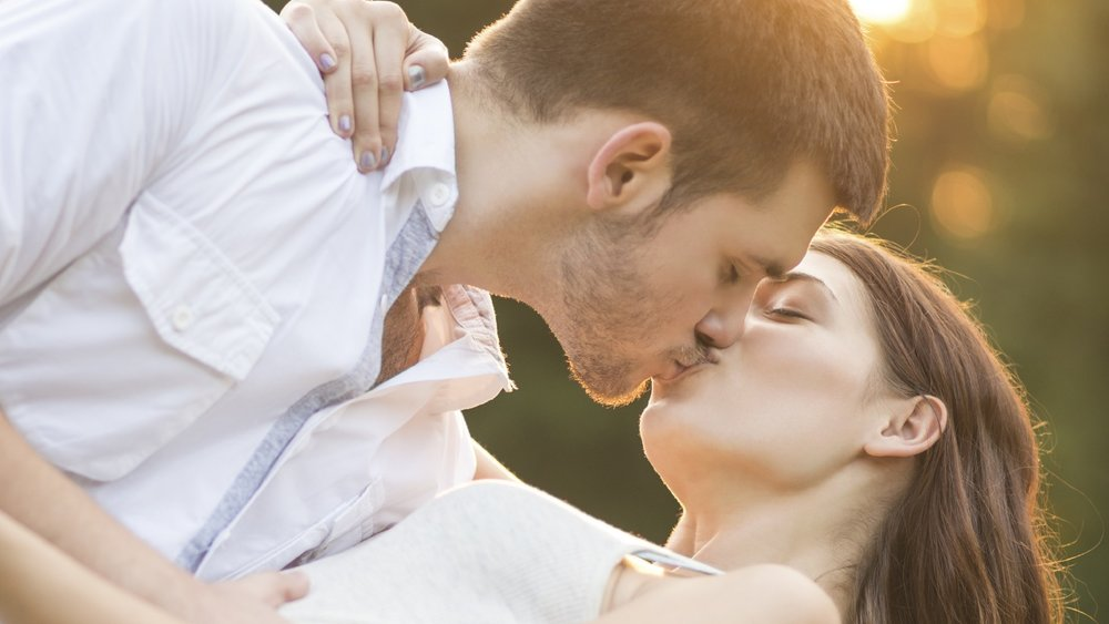 Loving couple kissing and embracing