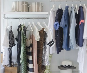 clothes hanging in closet with hat at home