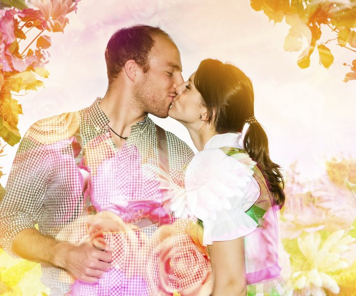 double exposure of couple kissing and flower arrangement
