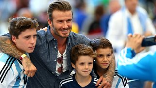 RIO DE JANEIRO, BRAZIL - JULY 13: Former England international David Beckham and sons Brooklyn Beckham (L), Cruz Beckham (2nd R) and Romeo Beckham (R) prior to the 2014 FIFA World Cup Brazil Final match between Germany and Argentina at Maracana on July 13, 2014 in Rio de Janeiro, Brazil. (Photo by Michael Steele/Getty Images)