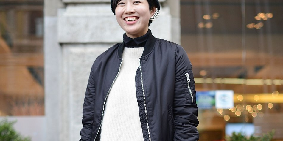 MILAN, ITALY - JANUARY 17: Chikako Ichinoi poses wearing a Topshop bomber, Strasburgo sweater and Marni bag on January 17, 2015 in Milan, Italy. (Photo by Vanni Bassetti/Getty Images)