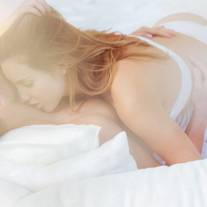 Beauty couple in passionate embrace in bed